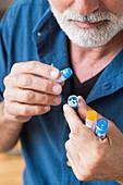 Man taking homeopathic medicine
