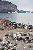 Rubbish dump and icebergs, Uummannaq, Greenland