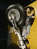 WWII, Woman Works on Landing Gear, 1943