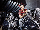 WWII, Woman Working on Airplane Motor, 1942
