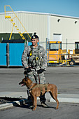US Air Force soldier with bomb-sniffing dog