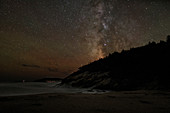 Sand beach and Milky Way at night