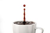 Single coffee drop splash in mug, illustration