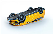 Yellow car crashed upside down, illustration