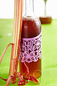 A bottle of homemade rhubarb syrup