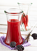 Homemade blackberry syrup with chilli and vanilla