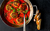 Cod cakes in tomato sauce
