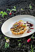 Natural cuisine: tart tatin with knotweed, duck liver and radish vinaigrette