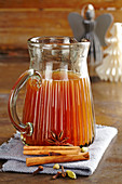 Christmas spiced syrup with cinnamon, cloves and cardamom for punch and hot drinks