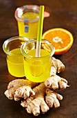 Homemade ginger and orange syrup in jars