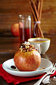A baked apple with almonds, sultanas and syrup (Christmas)