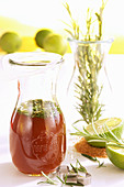 Homemade rosemary syrup with limes and cane sugar