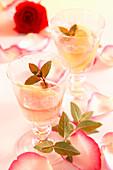 Homemade rose juice with sugar, lemon and fresh rose petals