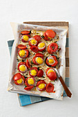 Oven-roasted tomatoes with quail's eggs and thyme