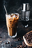 Iced coffee and coffee beans