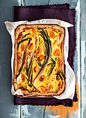Spring onion and tomato tart with black caraway seeds