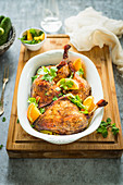 Roasted duck legs with oranges and chinese five spices with coriander
