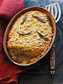 Millet semolina and pumpkin bake with pine nuts and sage