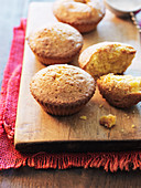 Corn muffins on a wooden chopping board