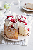 Angel cake with coconut cream and raspberries