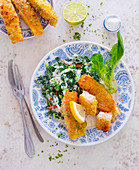 Fish fingers with creamy spinach