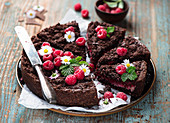Chocolate crumble cake with raspberries and coconut