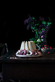 A Bundt cake, strawberries and lilac