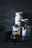 Tiramisu with blueberries in a jar