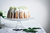 Rhubarb Elderflower Bundt cake with white chocolate glaze
