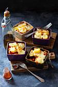 Sausage and veggies bake with potatoes and mozzarella