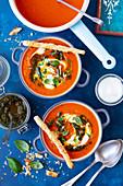 Tomato and pumpkin cream soup with pesto