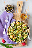 Potatoes and sour cucumber salad with mustard