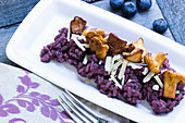 blueberry risotto with chanterelle mushrooms and shaved Parmesan
