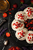Meringue Nests with cream, strawberries and lavender
