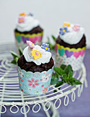 Chocolate cupcakes with flowers decoration