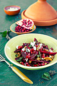 Beetroot salad with feta cheese and pomegranate seeds (vegetarian)