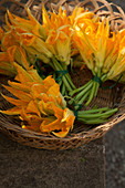 Courgette flowers in a basket