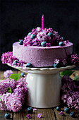 Blueberry cream cake with lilac flowers