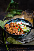 Lamb bhuna curry with rice in a blue bowl (India)