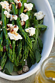 Green asparagus salad with rocket, cream cheese and hazelnuts
