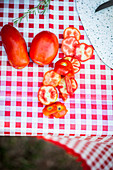 Sliced tomatoes on a camping table