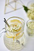 Homemade elderflower juice in a pitcher