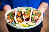 Tacos with fried avocado, red cabbage roasted corn and sriracha mayonnaise