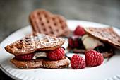 Chocolate waffels raspberries vanillia ice cream and chocolate sauce