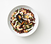 Red rice salad with seafood