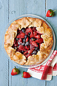 Fruit tart with strawberries, cherries and raspberries