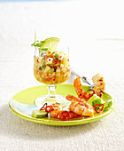 Pineapple salsa with fried prawns on a green plate