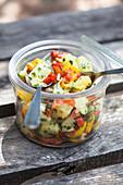 A jar of potato and pepper salad