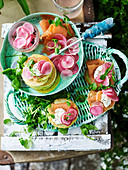 Green blinis with smoked ocean trout and quickled radish