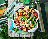 Potato and chorizo salad with roast tomato dressing